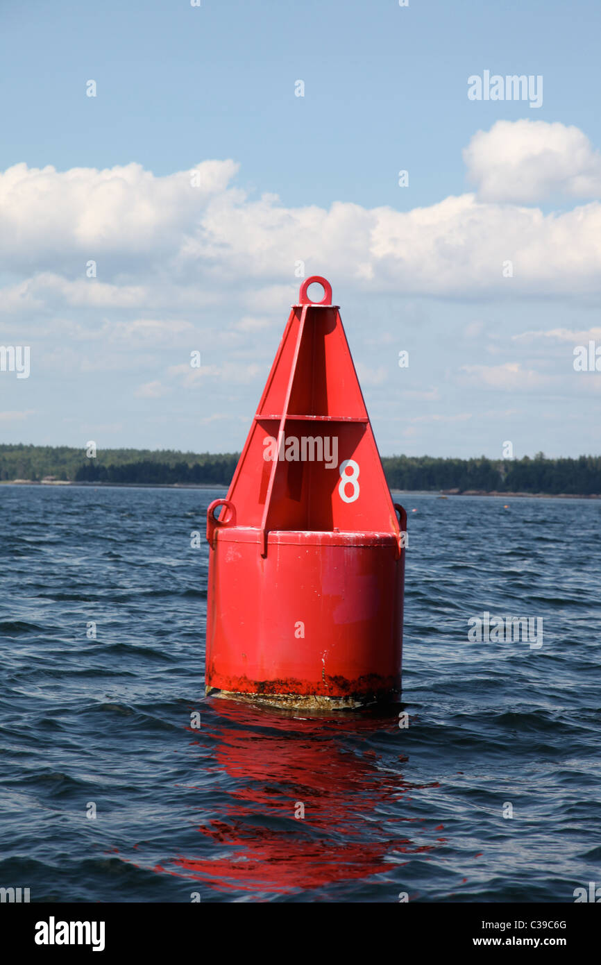 red buoy number 8 in ocean - Stock Image
