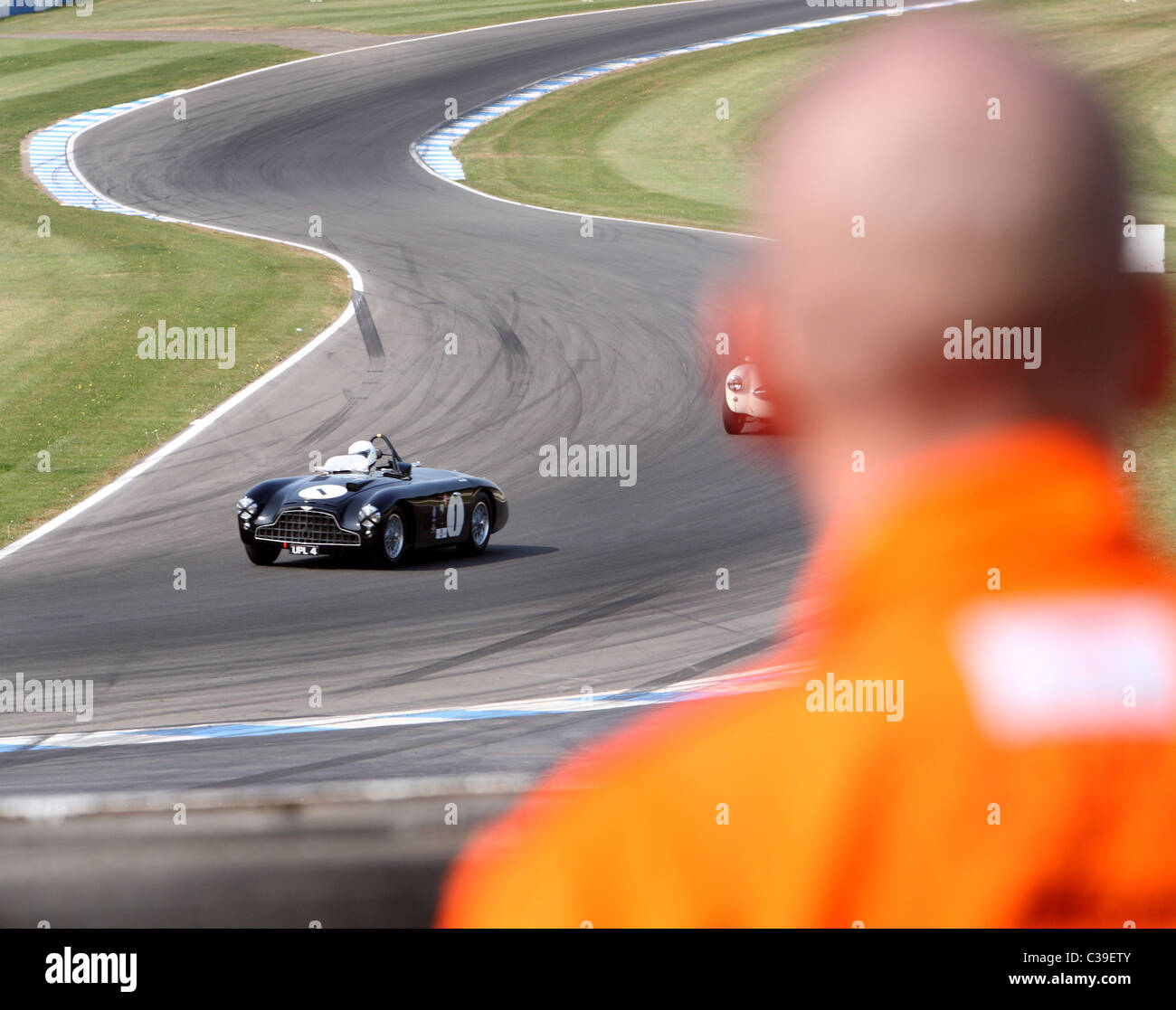 Aston Martin DB3 on track as viewed by race marshal - Stock Image