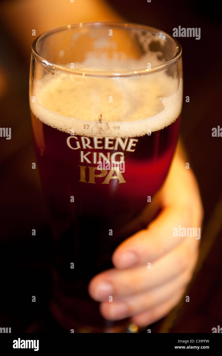 A pint of Greene King IPA in a branded glass. - Stock Image