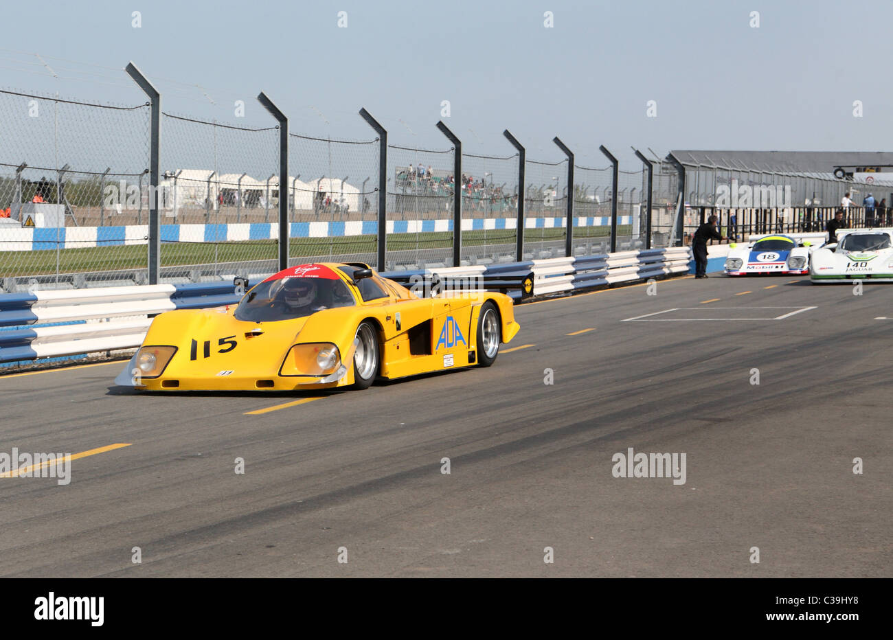 Group C sports cars in the pit lane at the Donington Historic Festival 2011 - Stock Image