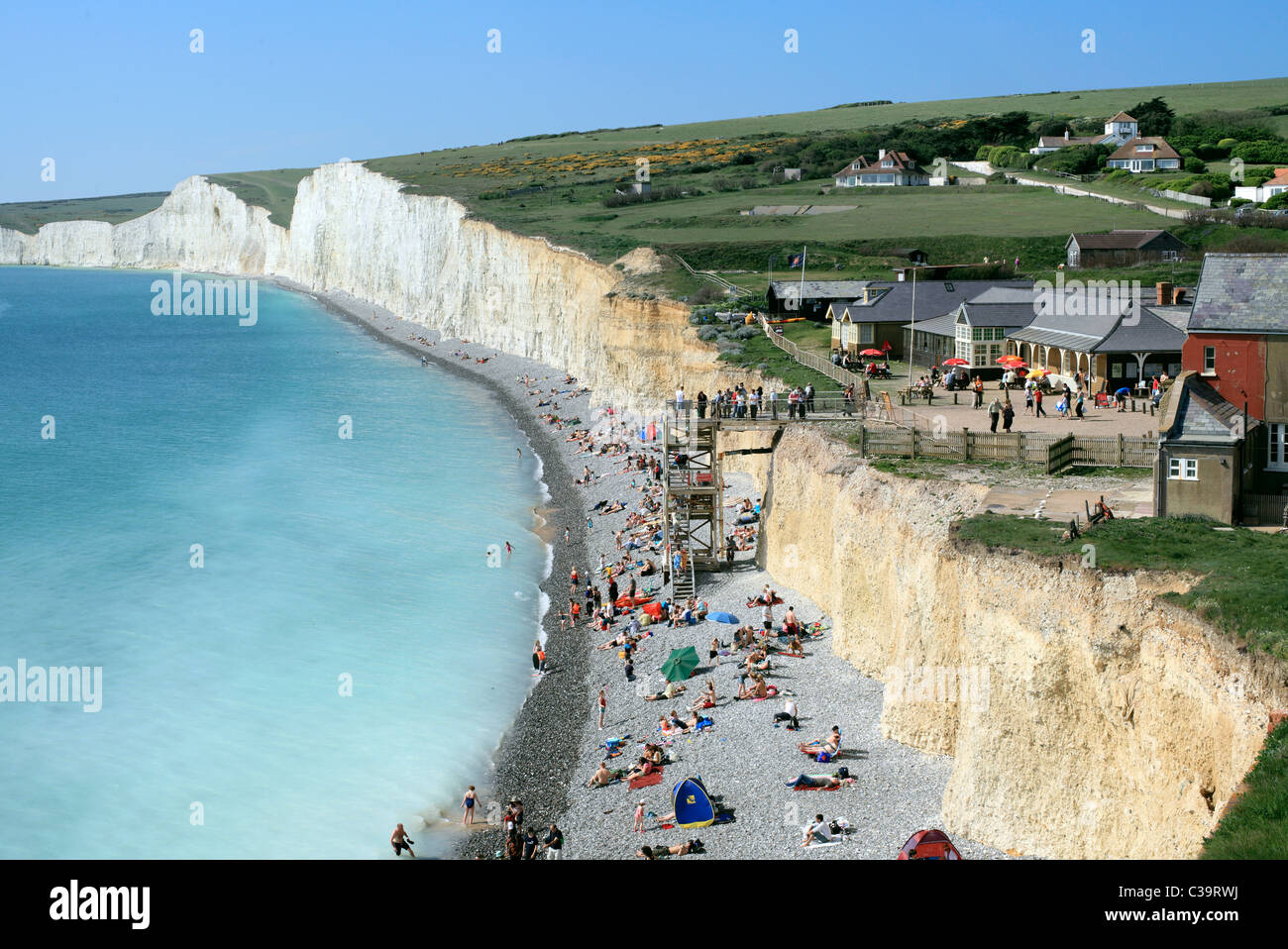 Birling Gap, between the Seven Sisters cliffs (background) and Beachy Head, East Sussex. Part of the South Downs - Stock Image