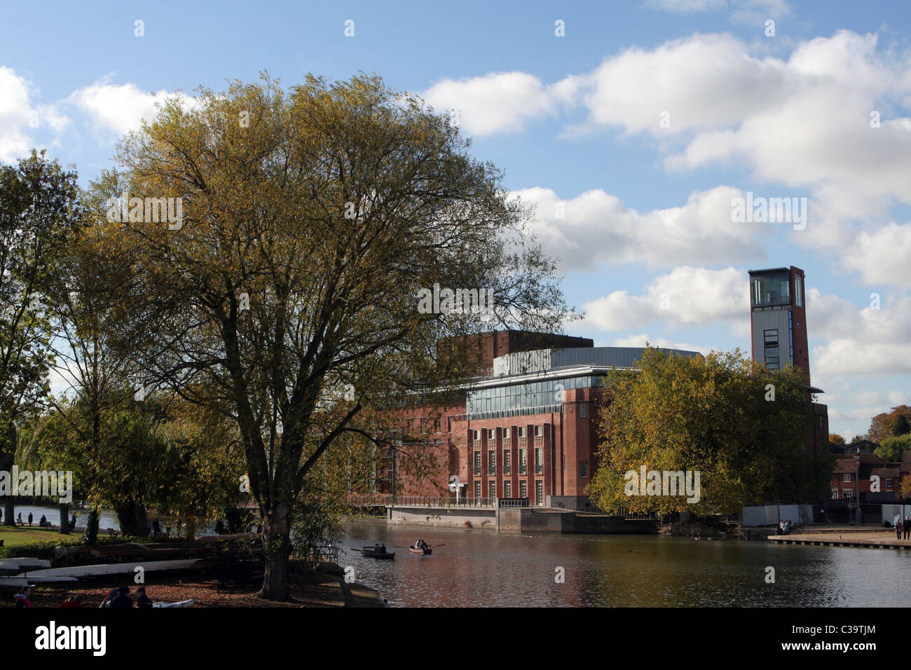 View of Royal Shakespeare Theatre over the River Avon in Stratford-upon-Avon,  Warwickshire, England, UK - Stock Image