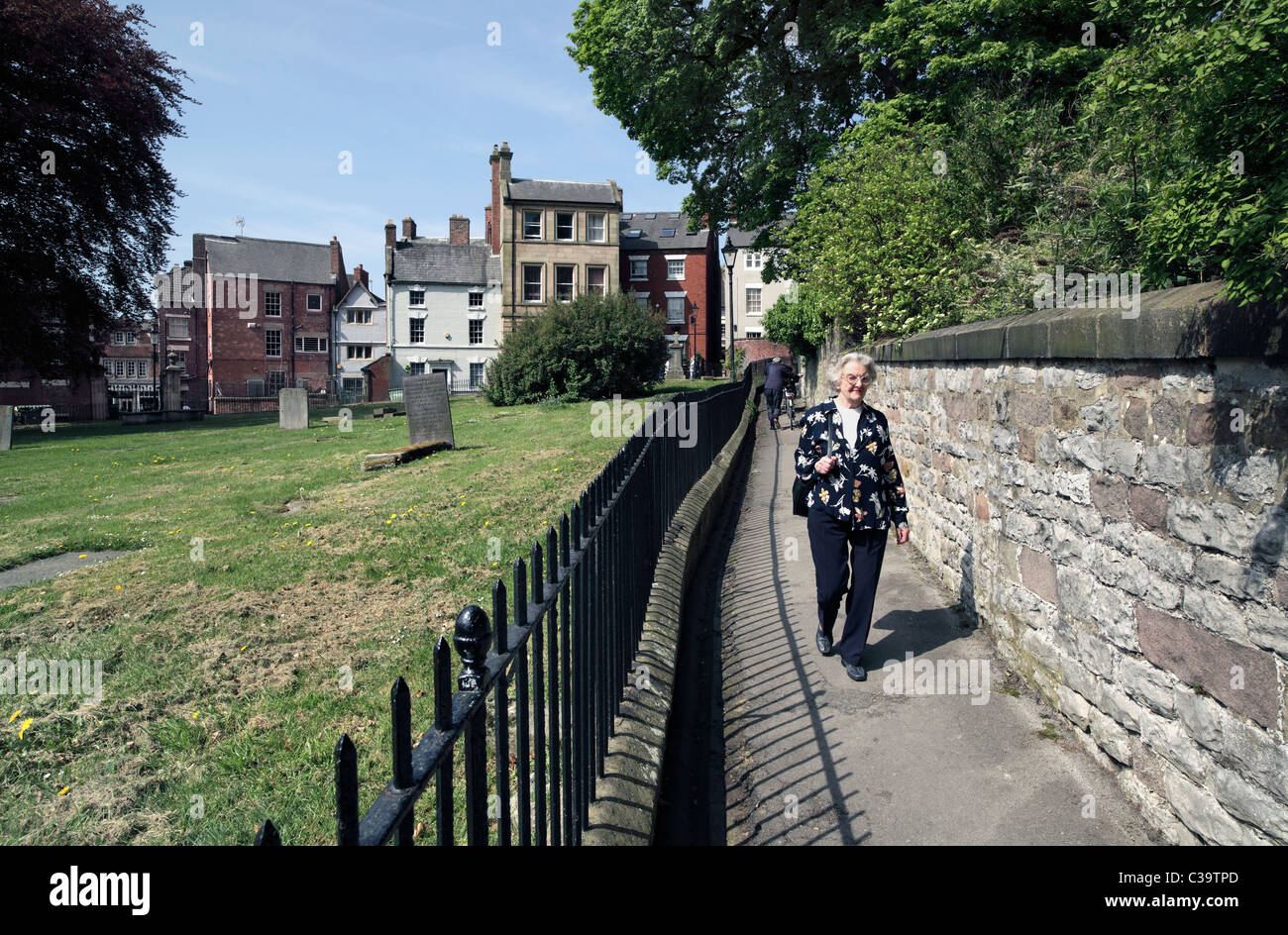 Church Walk, Wirksworth, Derbyshire - a footpath route around the churchyard (left) of St Mary's Church, next - Stock Image