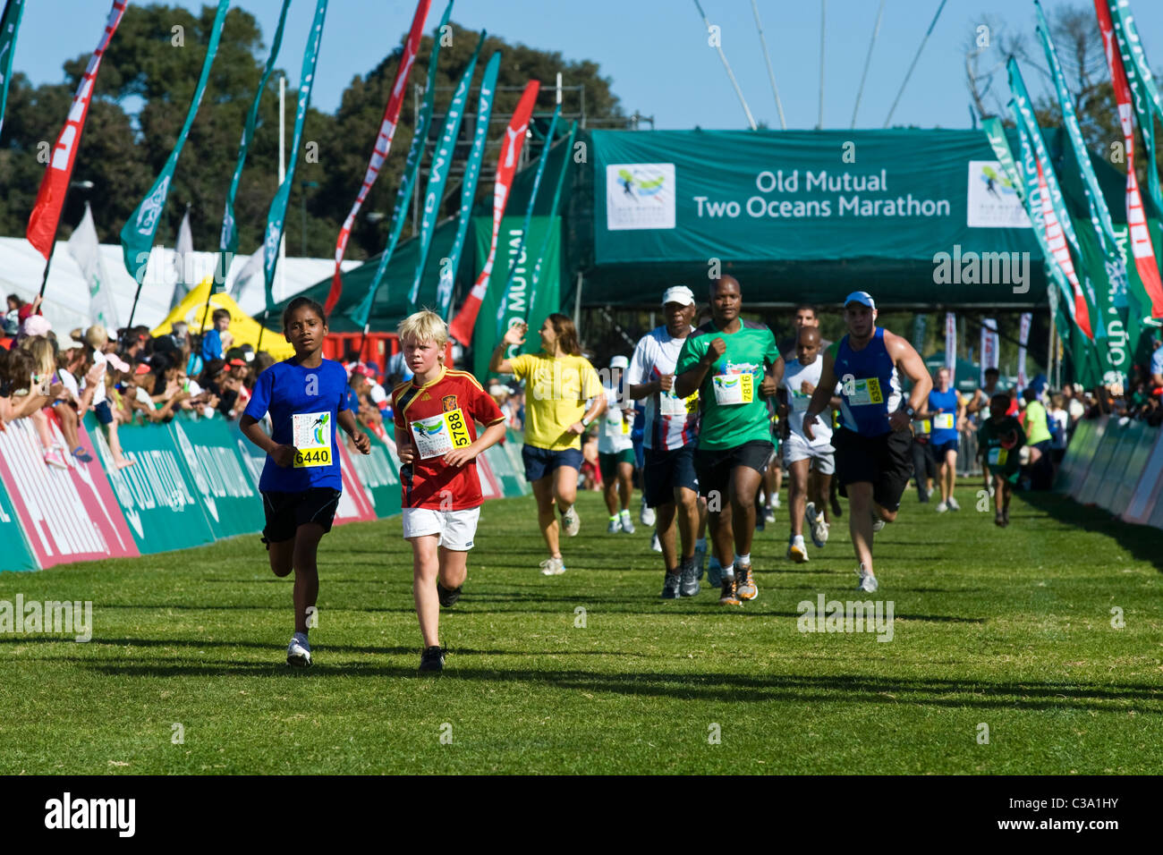 Teenagers at the finish of the 5km Fun Run, Two Oceans Marathon, Cape Town, South Africa - Stock Image