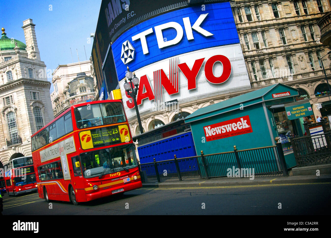 A buss traveling through central London. - Stock Image
