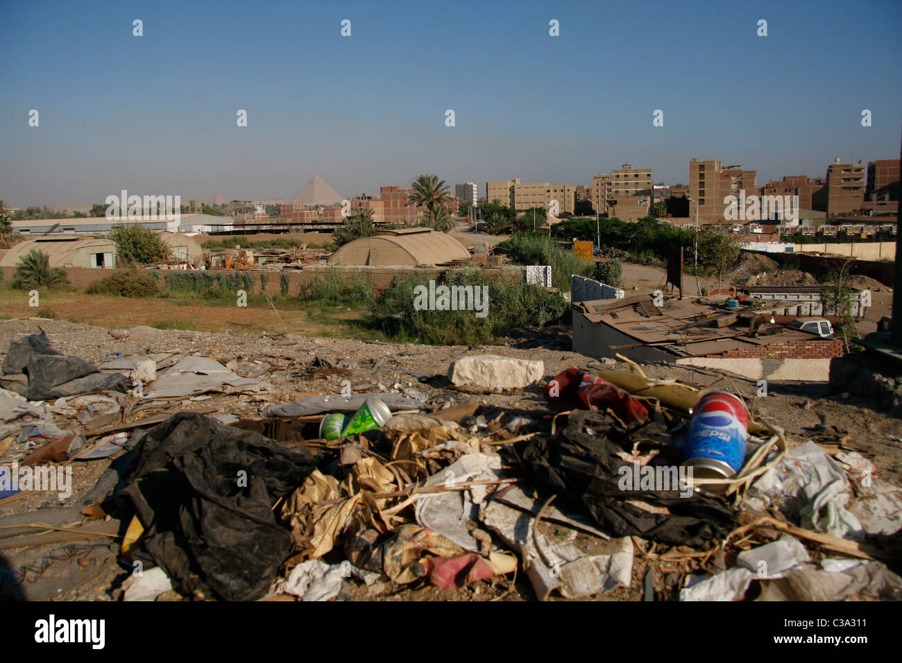 Garbage dumping ground next to the highway to Giza Pyramid. - Stock Image
