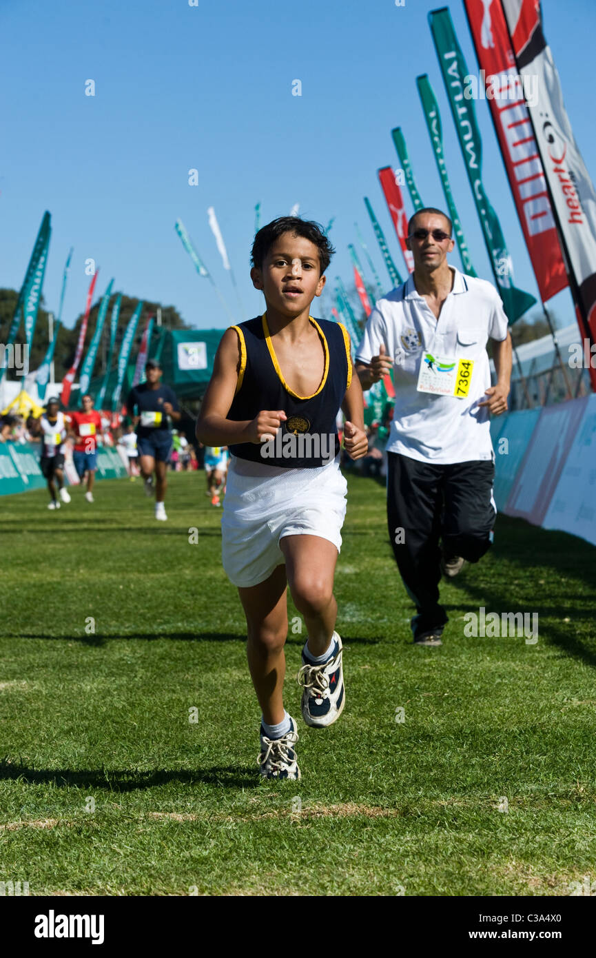 Boy at the finish of the 5km Fun Run, Two Oceans Marathon, Cape Town, South Africa - Stock Image