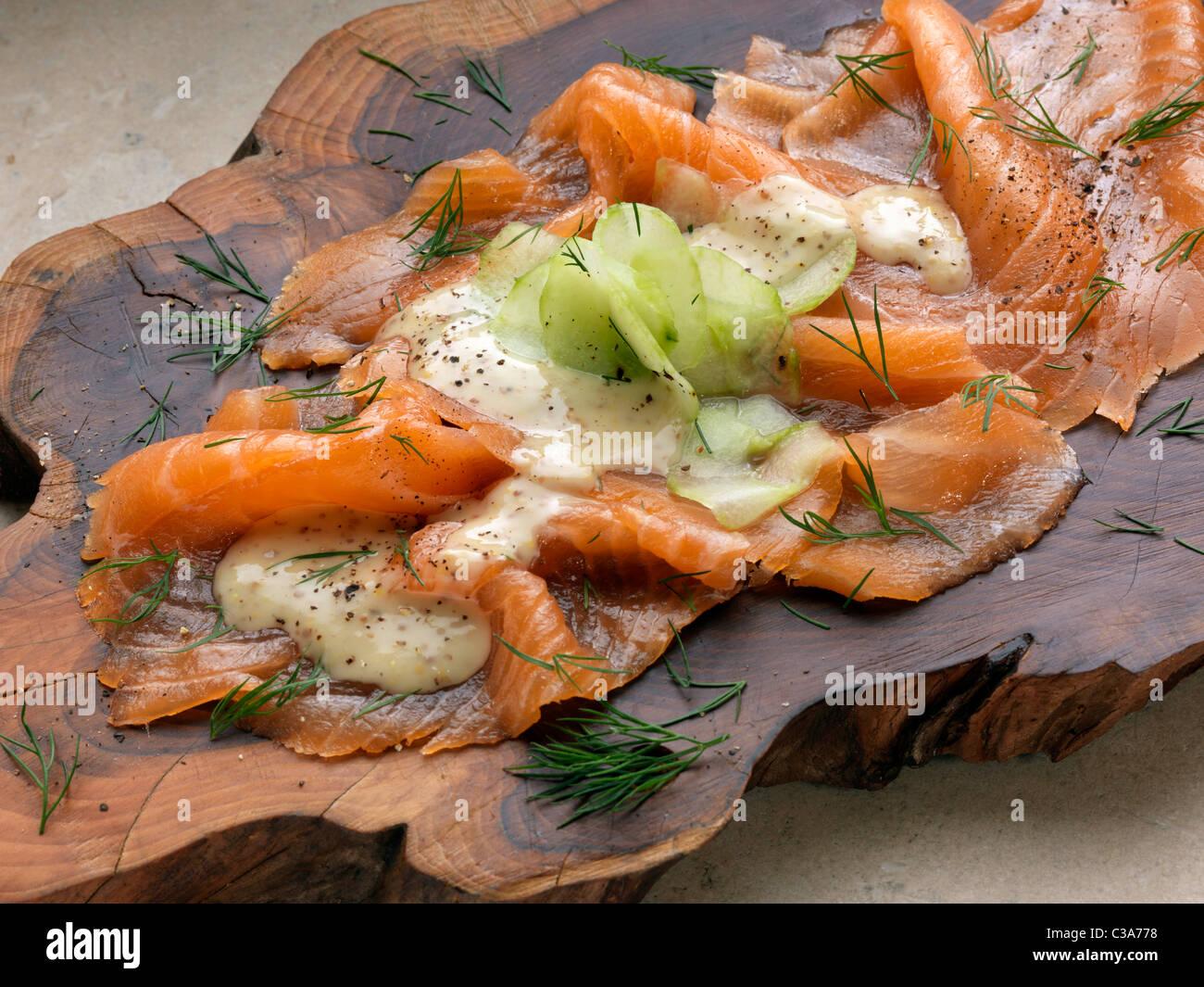 Gravadlax smoked salmon with dill cucumber mustard dressing Marco Pierre White recipe gravlax - Stock Image