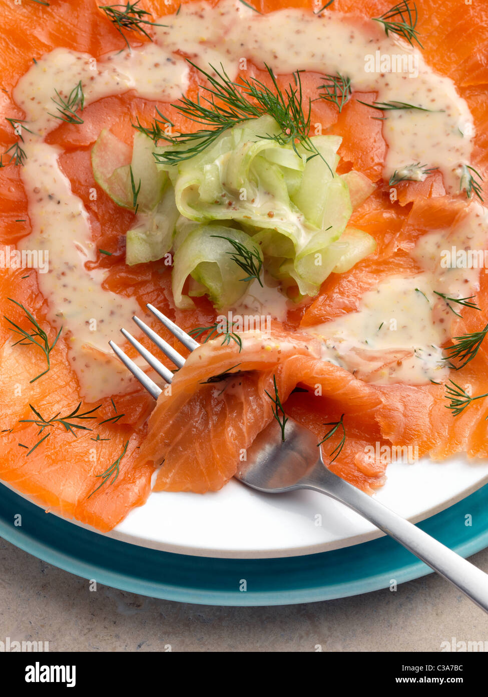 Gravadlax smoked salmon with dill cucumber mustard dressing Marco Pierre White recipe - Stock Image