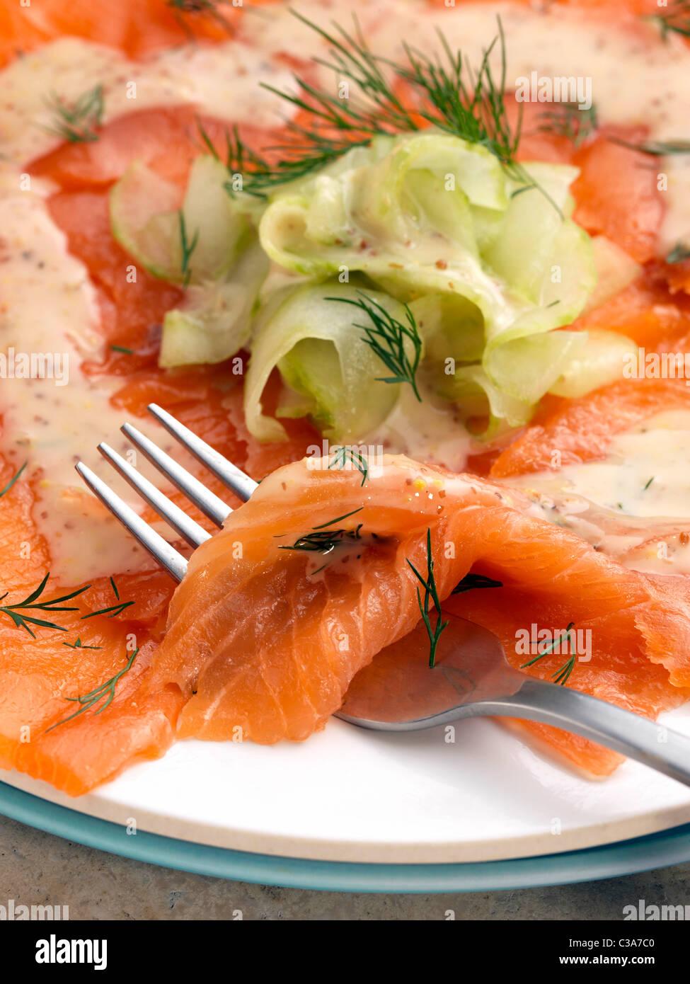 Smoked salmon gravadlax cucumber dill mustard dressing - Stock Image