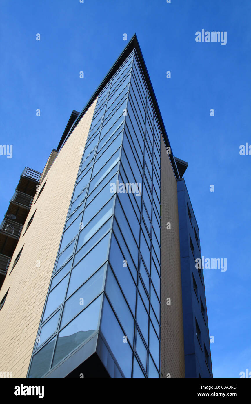 Office developments in Granary Wharf Leeds, West Yorkshire, highlighted against a bright blue spring sky - Stock Image