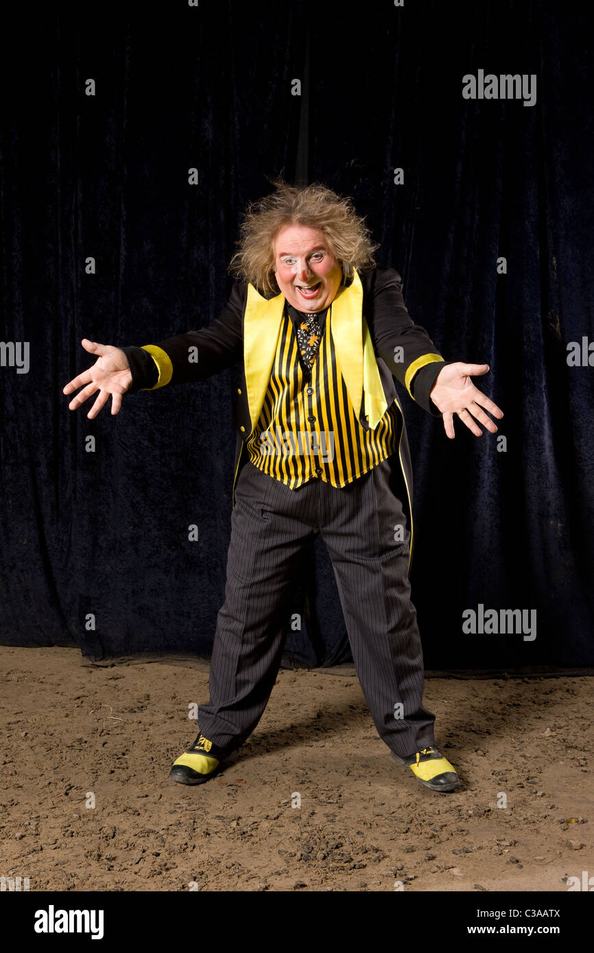 Circus Clown Waving Arms - Stock Image