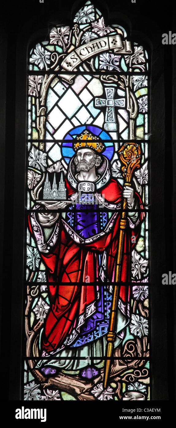 A stained glass window depicting St Chad, All Saints Church, Chebsey, Staffordshire - Stock Image