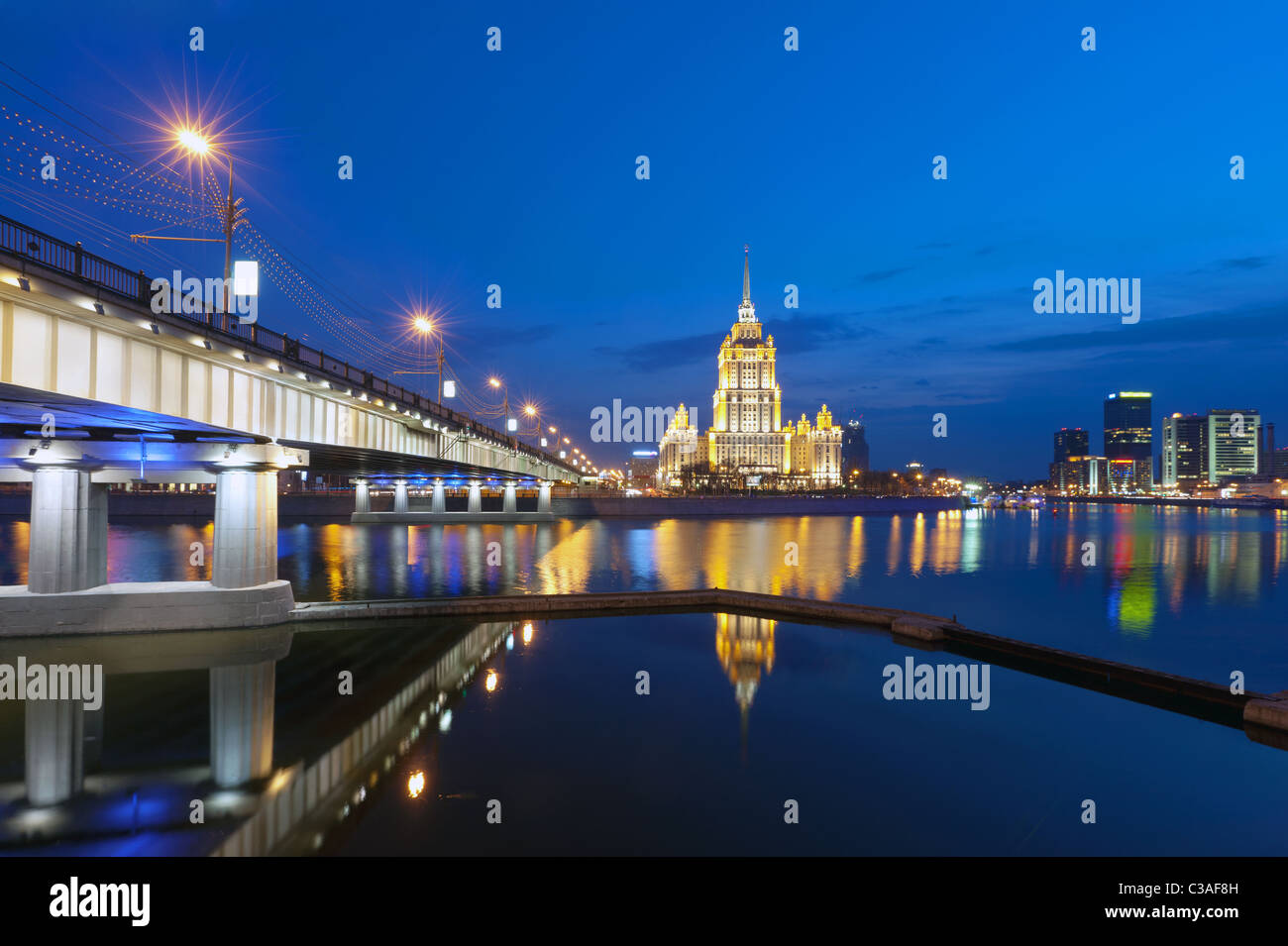 Night Moscow. Moscow River. Krasnopresnenskaya embankment , hotel Ukraine and  the New Arbat bridge. - Stock Image