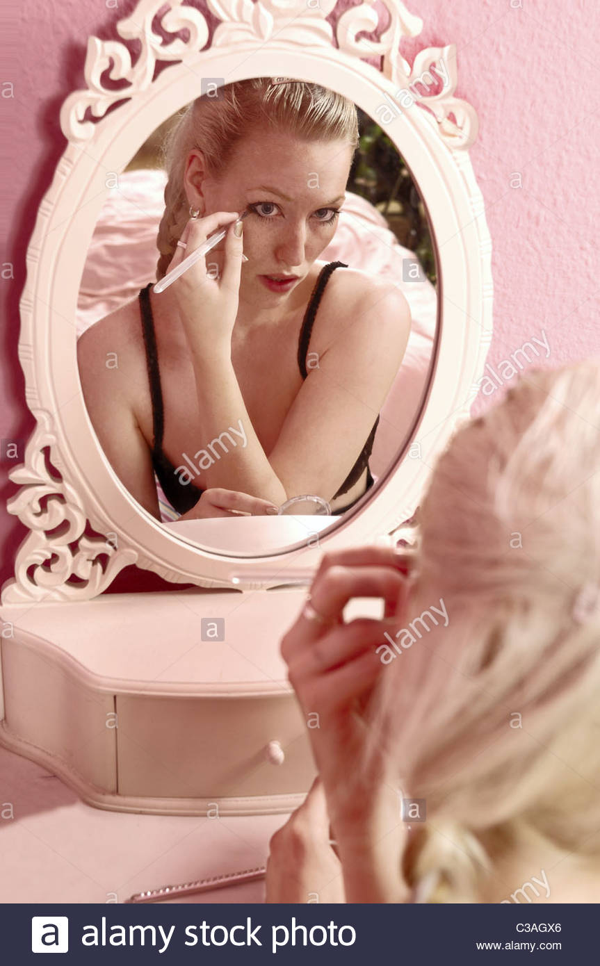 Young Woman In Front Of A Mirror In A Girls Room Stock Photo