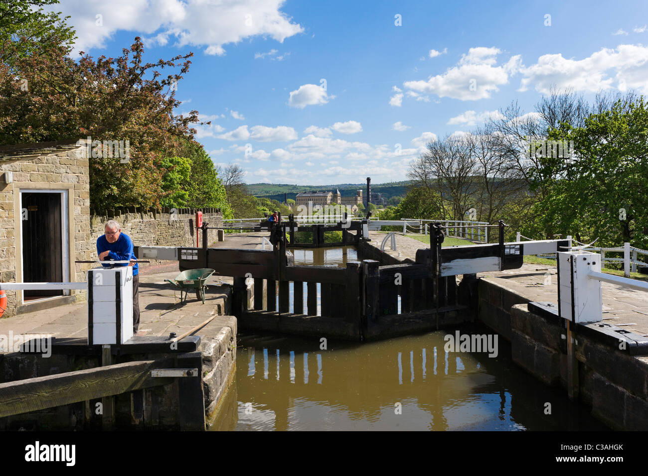 The lock keeper at the top of Five Rise Locks on the Leeds and Liverpool Canal, Bingley, West Yorkshire, UK - Stock Image
