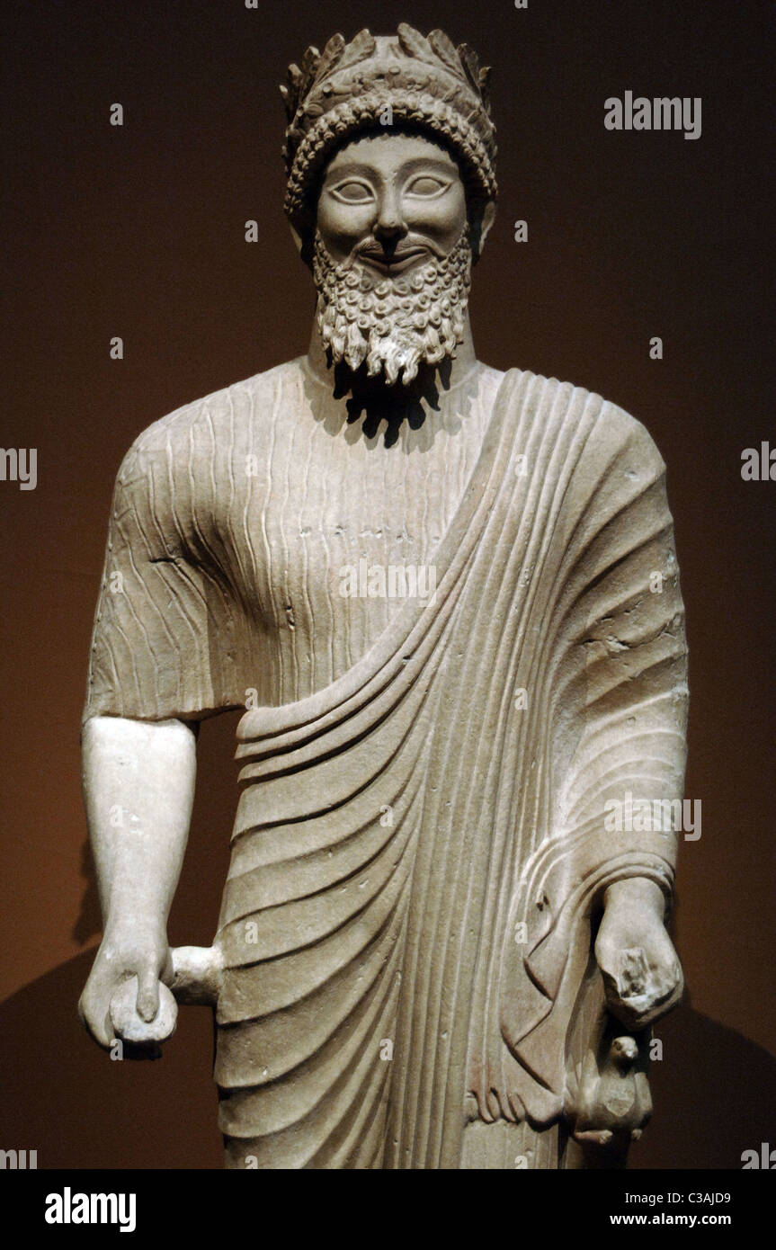 Phoenician art. Cyprus. Bearded man with votive offerings. Ca. 475-450 BC. Classical Period. Limestone. - Stock Image
