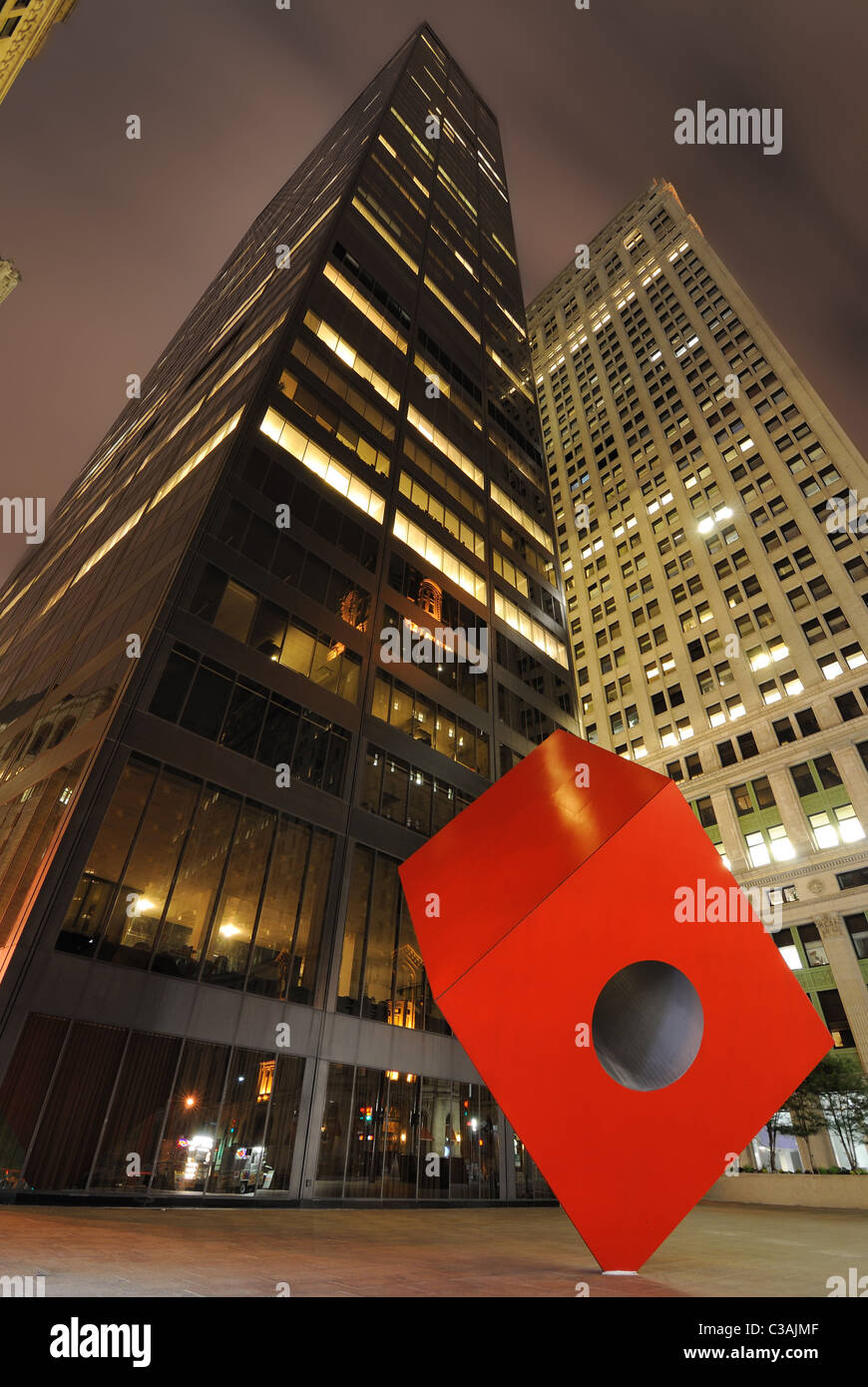 HSBC Building (aka Marine Midland Building) in New York City at night with Isamu Noguchi's Cube. - Stock Image