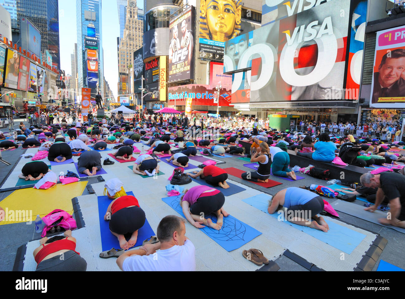 People participate in a yoga event in Times Square New York City. June 21, 2010. Stock Photo