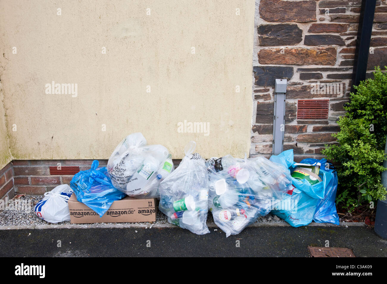 Recyclable household waste put out for kerbside collection. Householders sort the waste into eg glass, plastic, - Stock Image