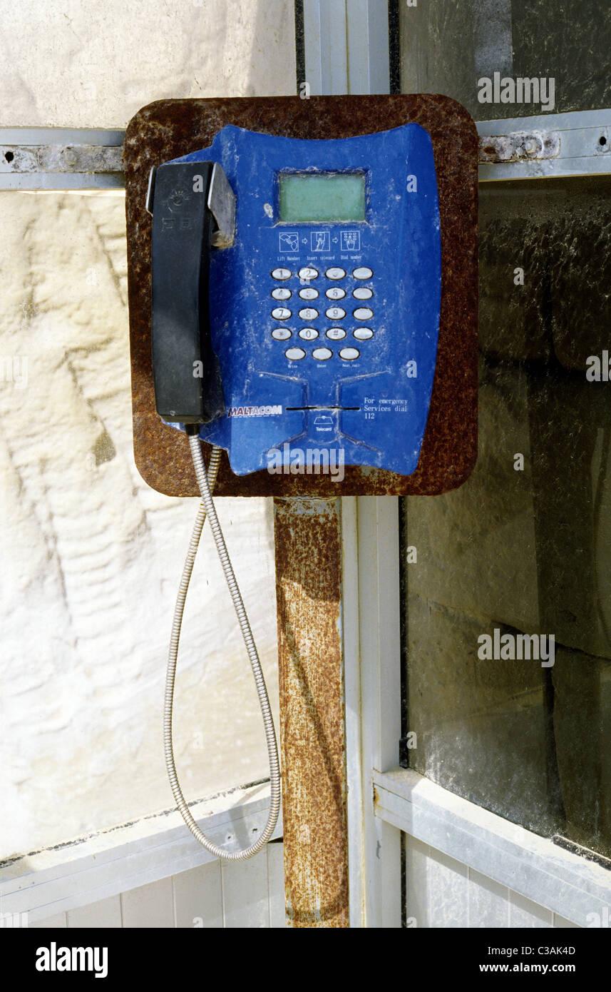 Weathered MALTACOM public phone at Dwejra Point on the Maltese island of Gozo. - Stock Image