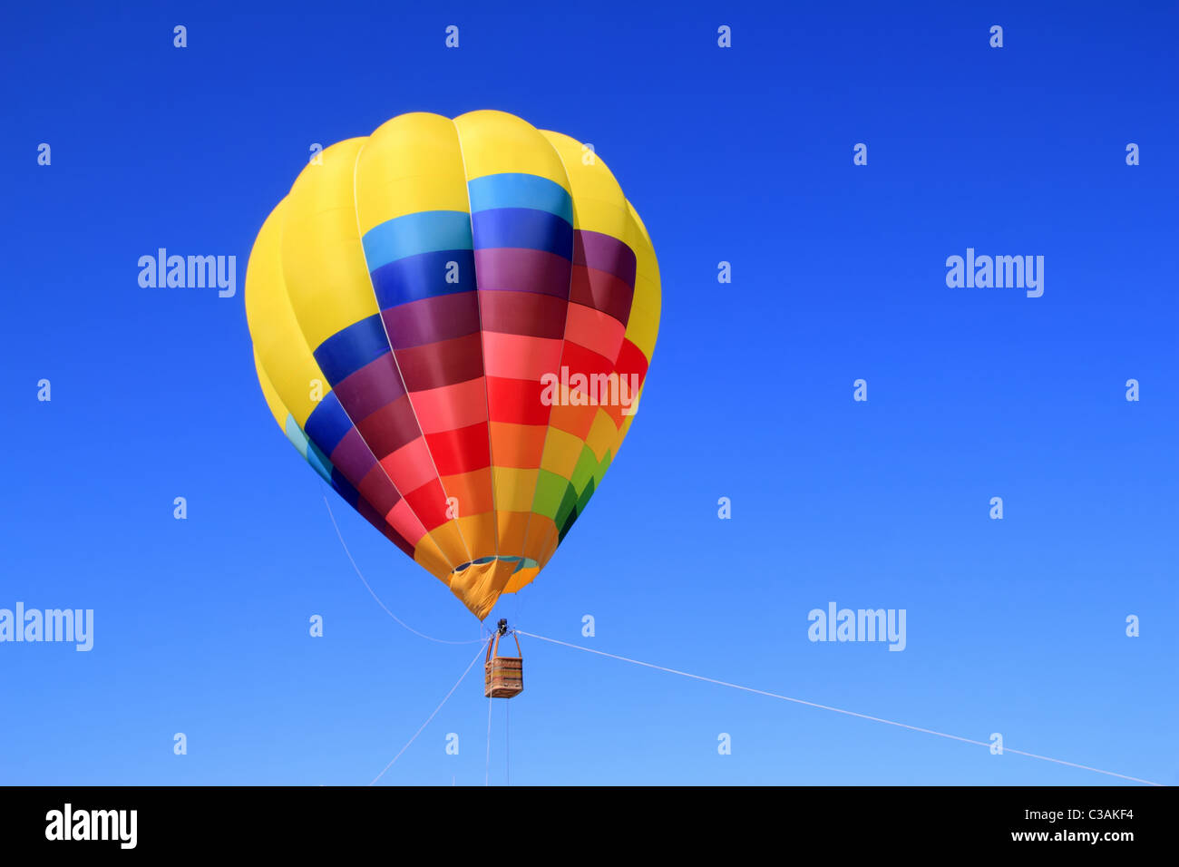 balloon colorful vivid colors in blue sky flying ship - Stock Image
