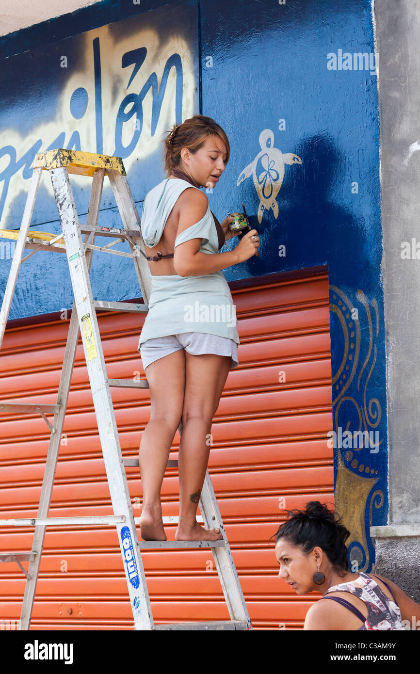 female sign painter, Punto Ayora, Santa Cruz Island, Galapagos Islands, Ecuador - Stock Image