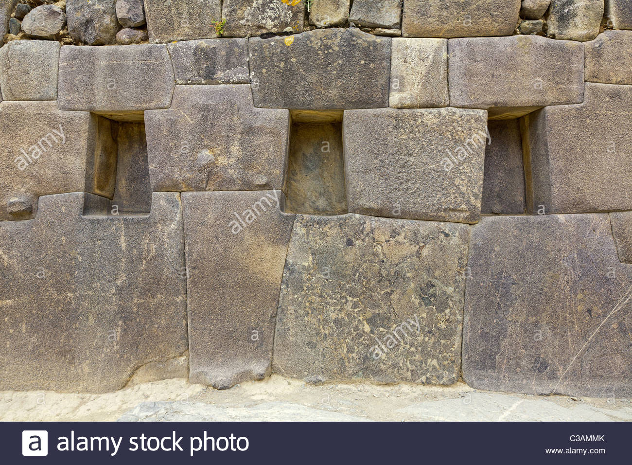 15th century Inca stonework with trapezoidal niches at Ollantaytambo ruins. Ollantaytambo, Peru. - Stock Image