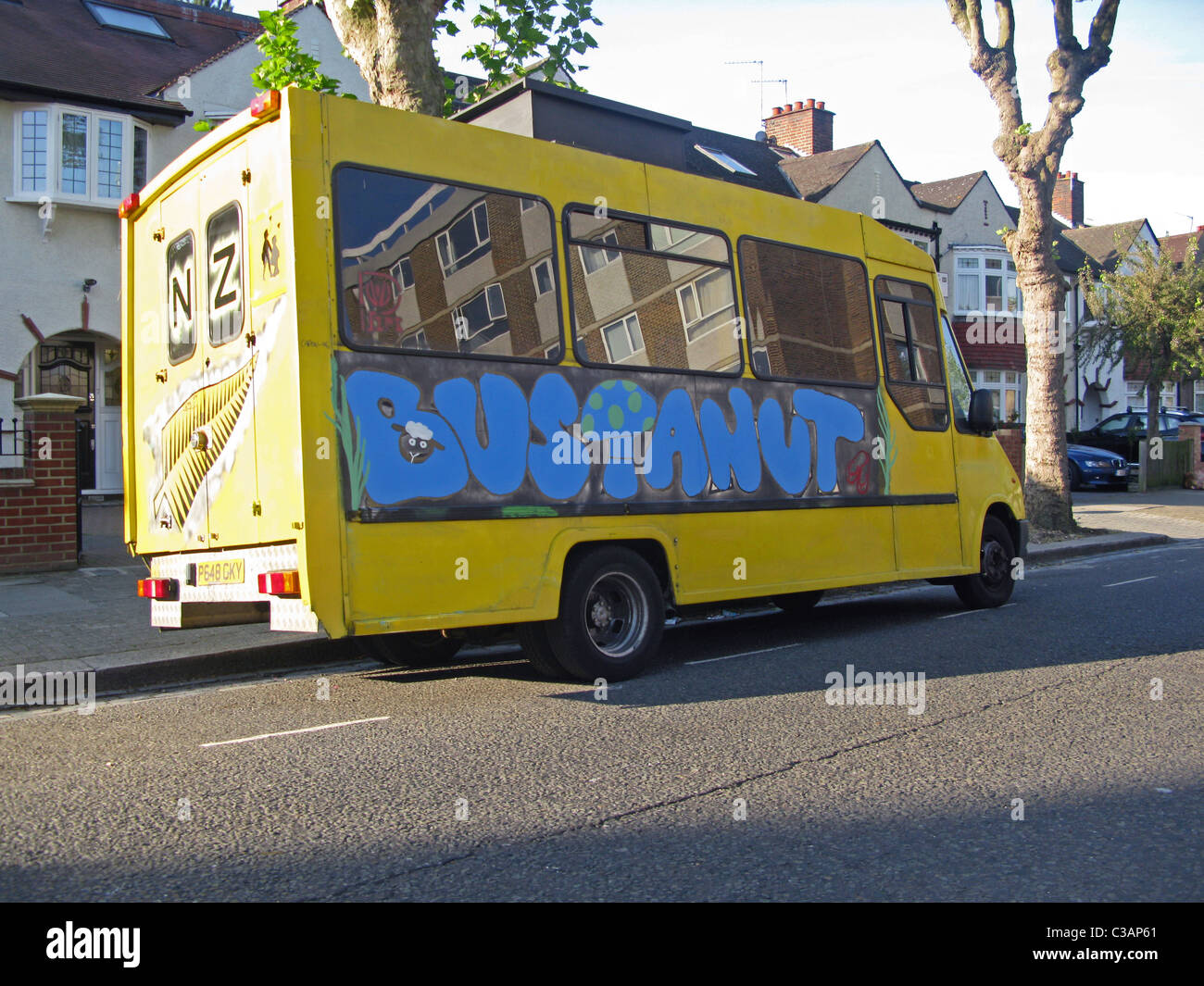 Old school bus decorated with graffiti - Stock Image