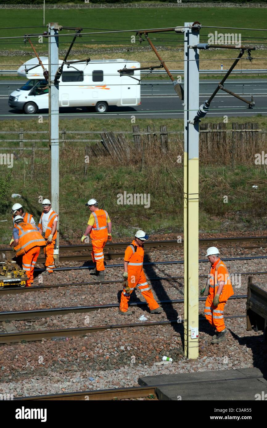 Hi-Visibility Babcock Rail Engineers repairing Train lines at Beattock Summit _Network Rail Contractors in Scotland, - Stock Image