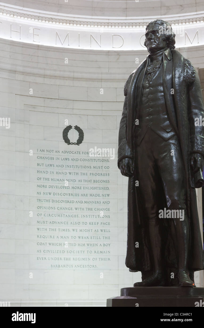 The statue of Thomas Jefferson and an excerpt from a letter Jefferson wrote on a wall in the Jefferson Memorial - Stock Image