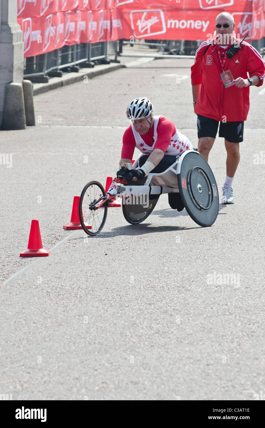 Rob Holliday Men's Wheelchair competitor in London marathon watched by crowds. 2011 - Stock Image