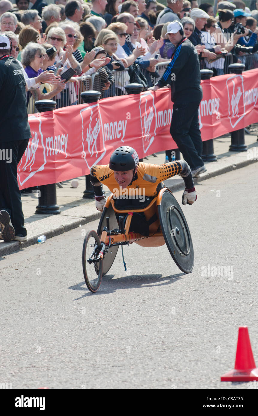 Paul Rea Men's Wheelchair competitor in London marathon watched by crowds. 2011 - Stock Image
