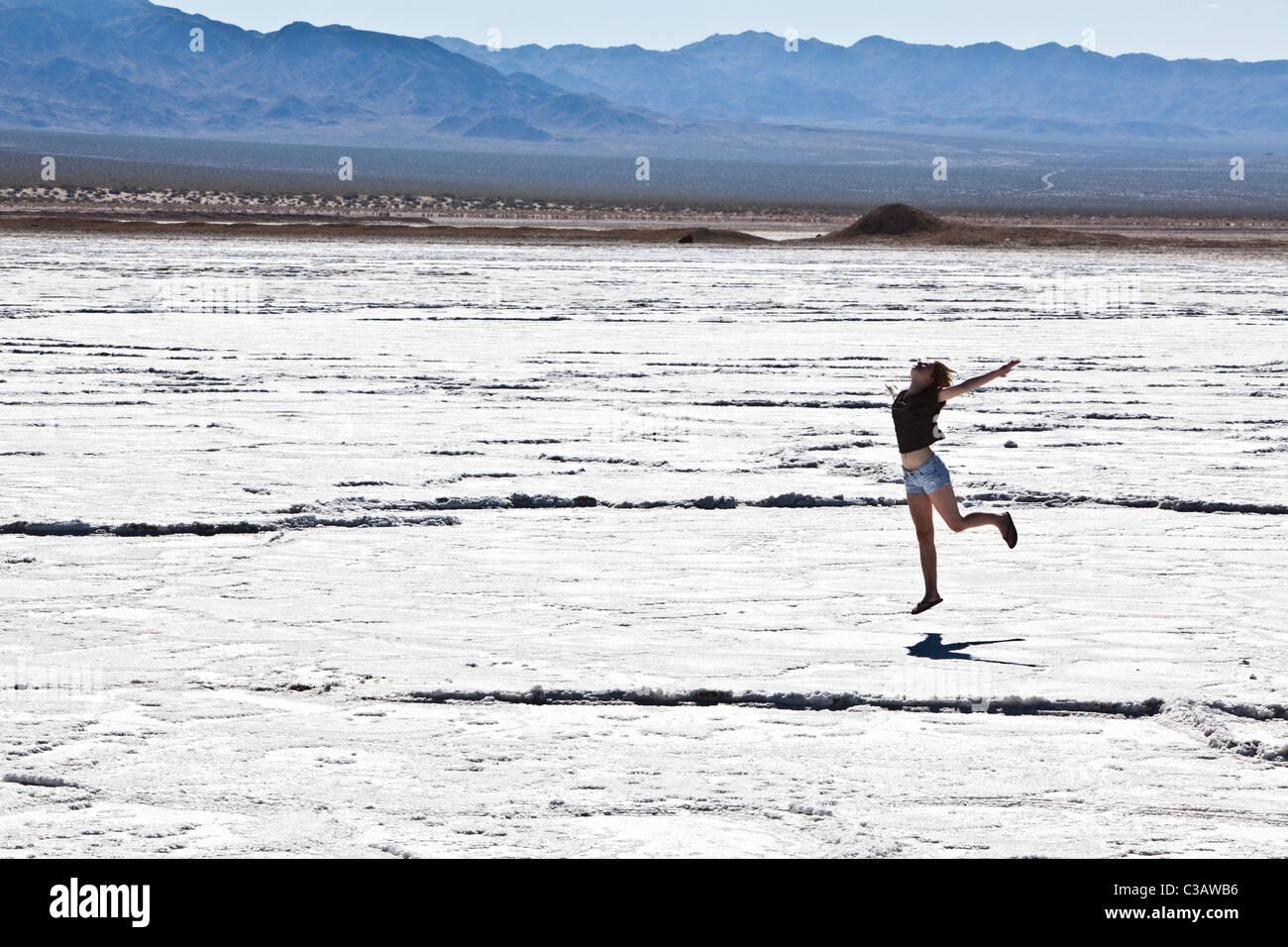Teenager playing, Bristol Lake (Dry Lake Bed) California, United States of America - Stock Image
