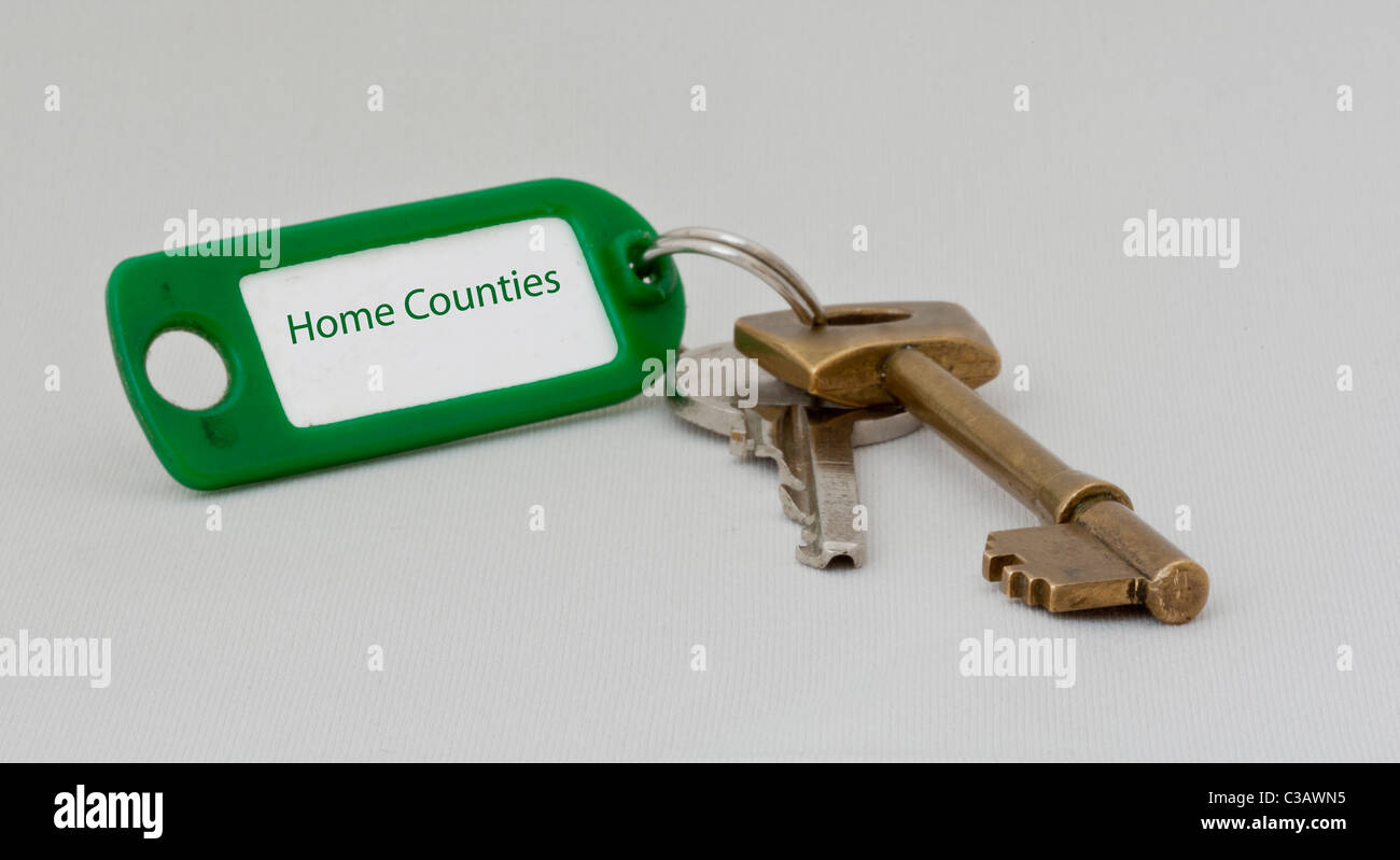 Two keys with a key tag with Home Counties written on it - Stock Image