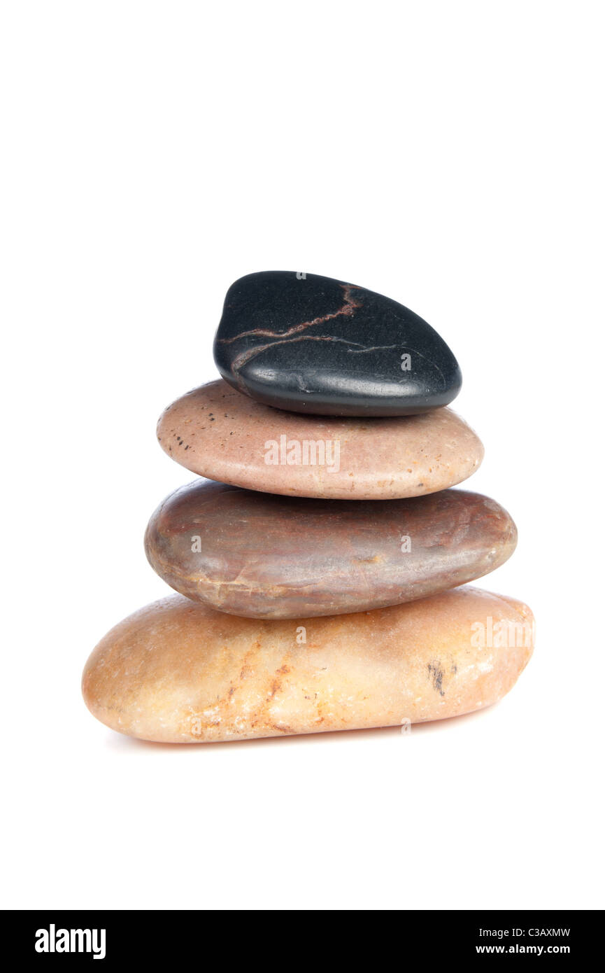 A stack of smooth, colorful river rock depicting a zen-like setting. - Stock Image