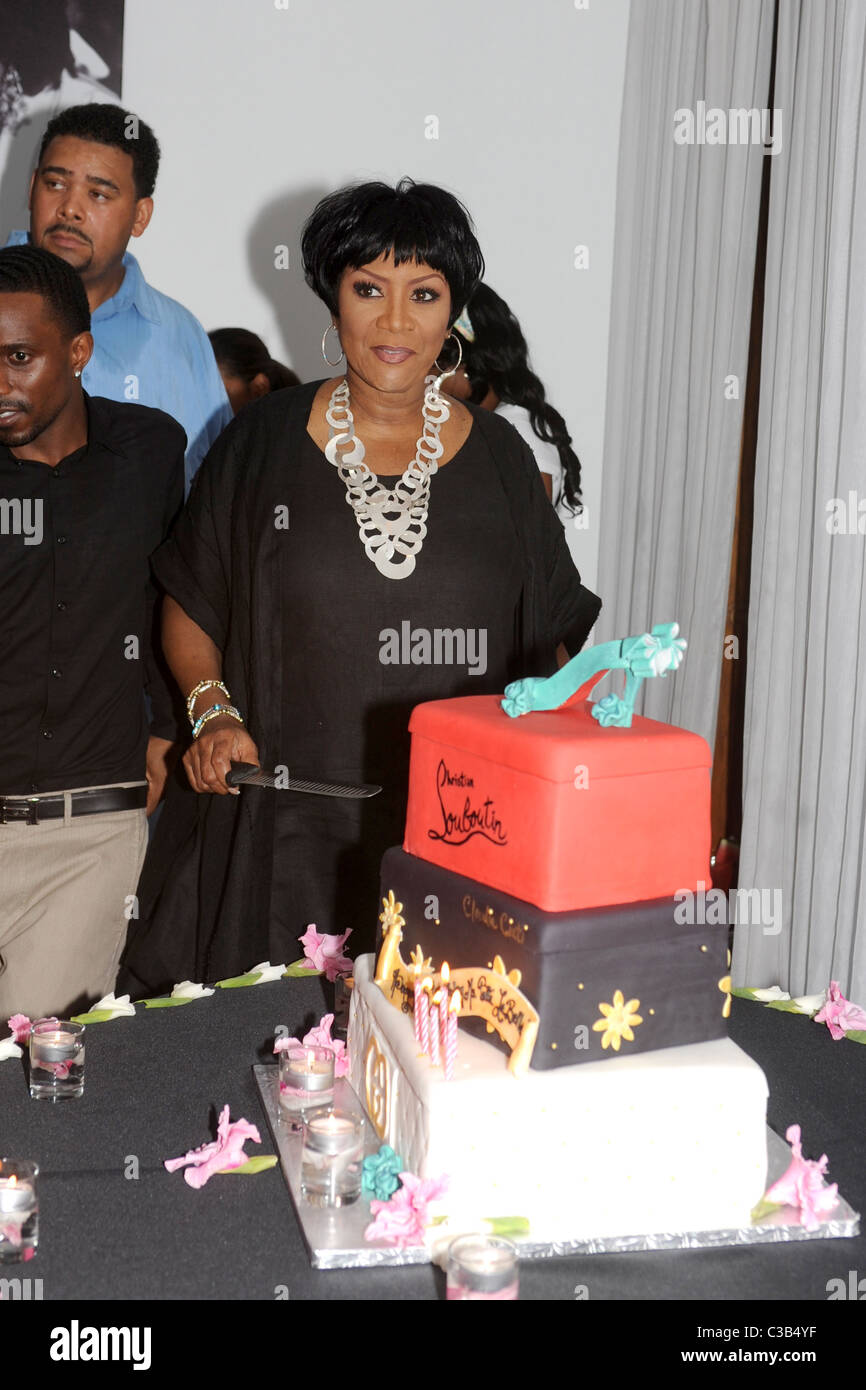 Patti LaBelle Prepares To Cut Her Christian Louboutin Cake As She Celebrates 65th Birthday At
