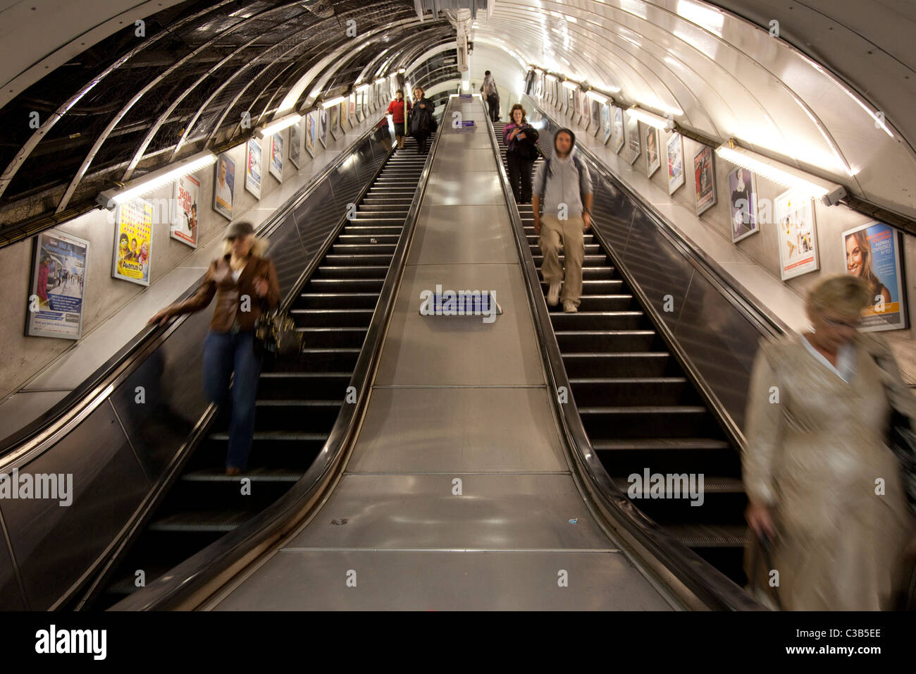 The underground escalator system at Oxford circus station. - Stock Image