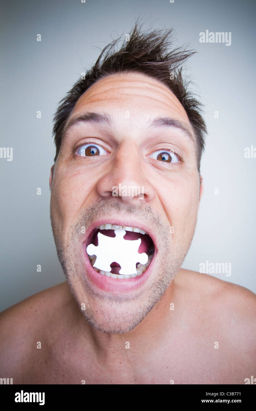 portrait of a man with jigsaw puzzle pieces - Stock Image