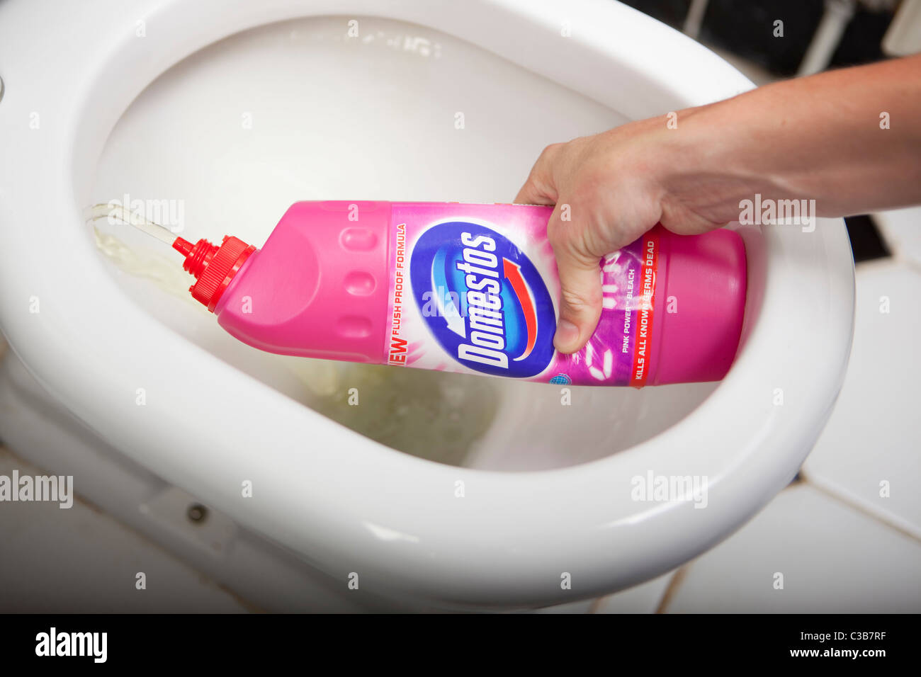 Illustrative image of a Domestos bleach bottle - Stock Image