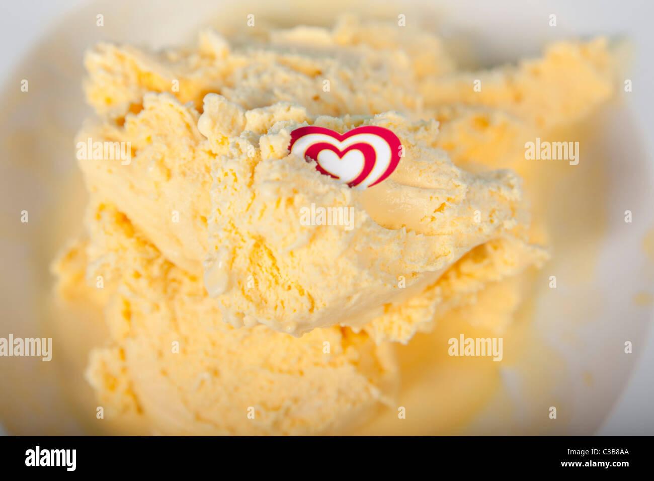 Illustrative image of Walls Cream of Cornish, soft scoop ice-cream. A Unilever brand. - Stock Image