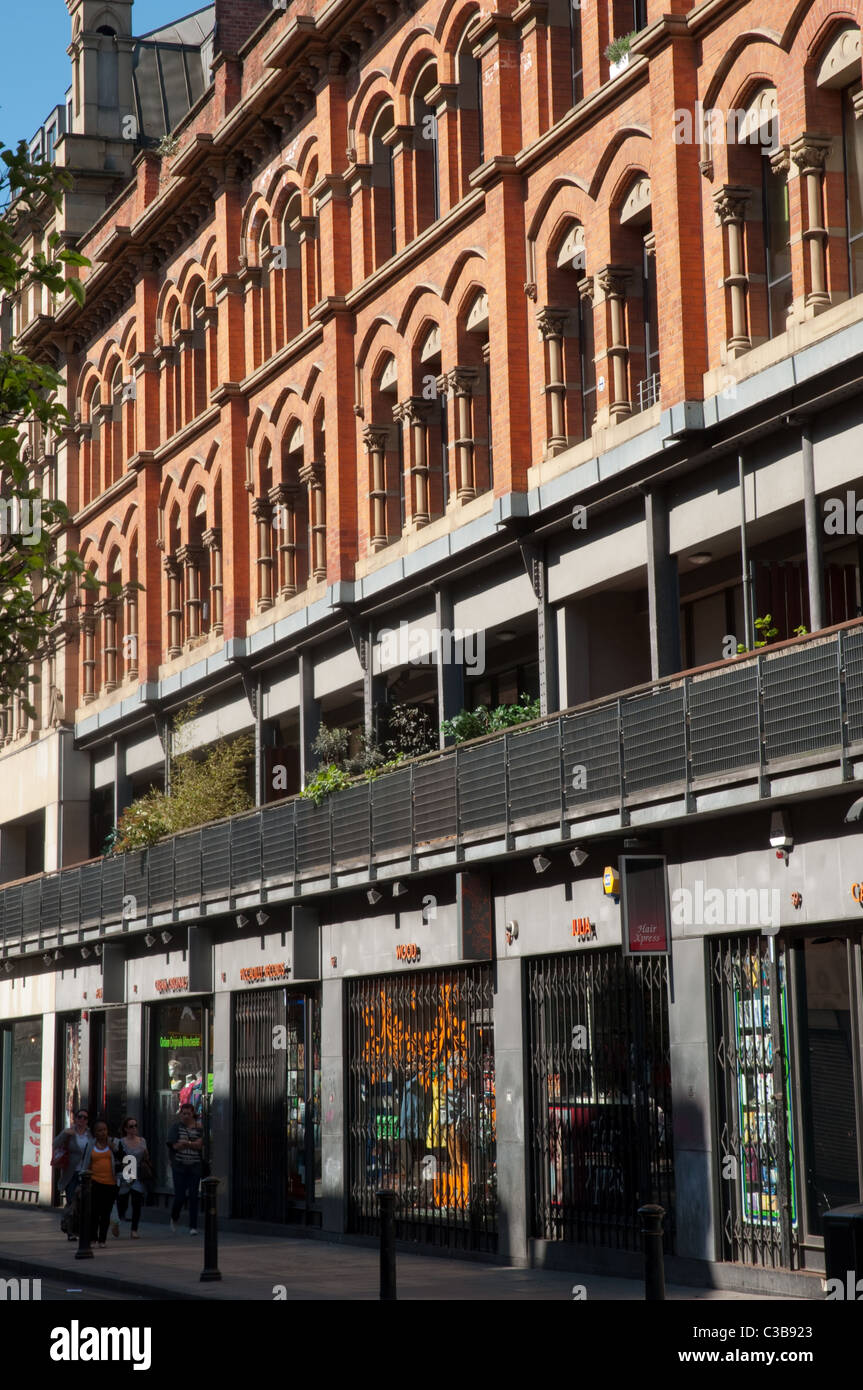 Contemporary retail units along Oldham Street part of the Northern Quarter, Manchester. - Stock Image