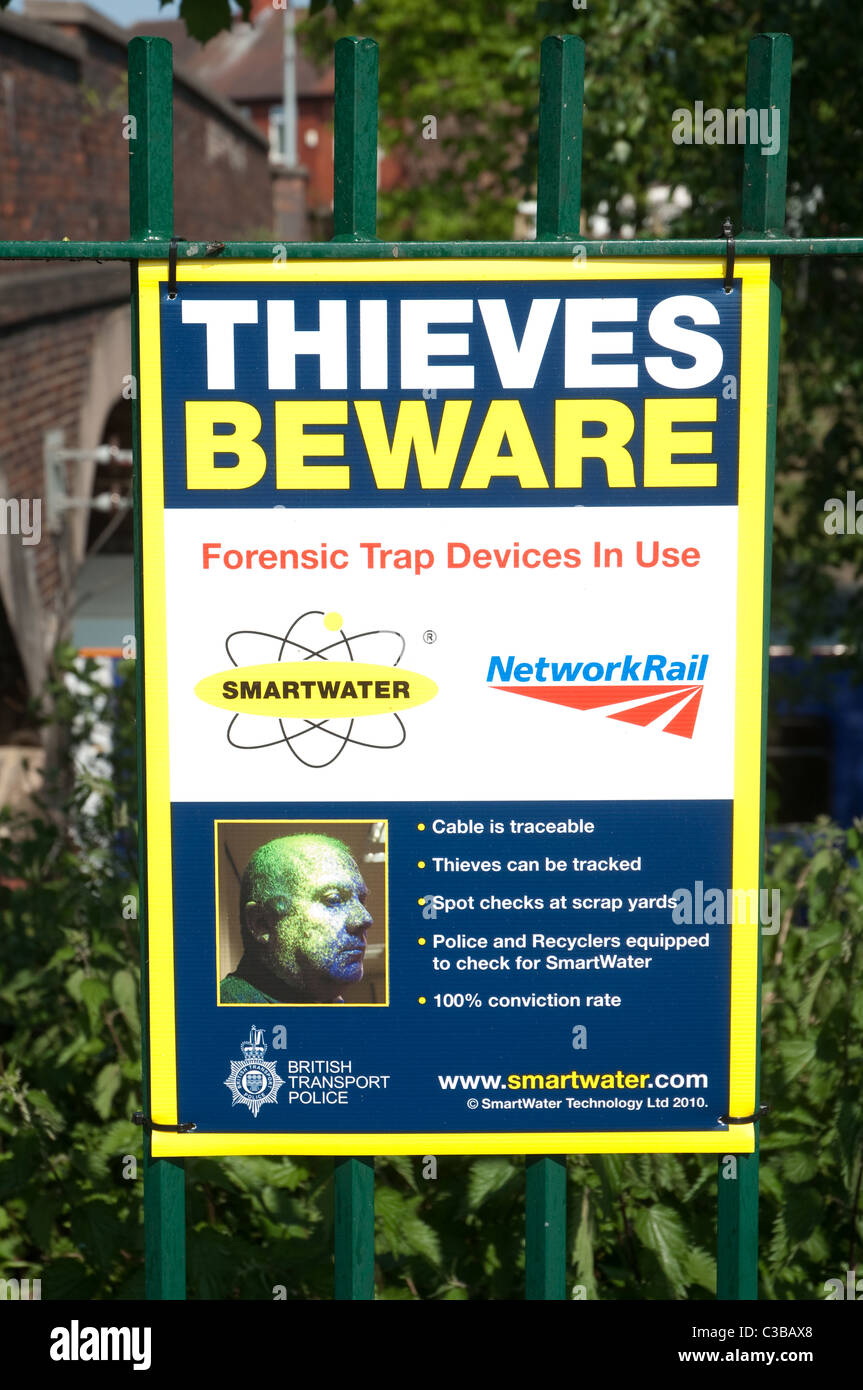 Thieves Beware a campaign poster highlighting  the high tech Smartwater technology used by Network Rail to catch - Stock Image