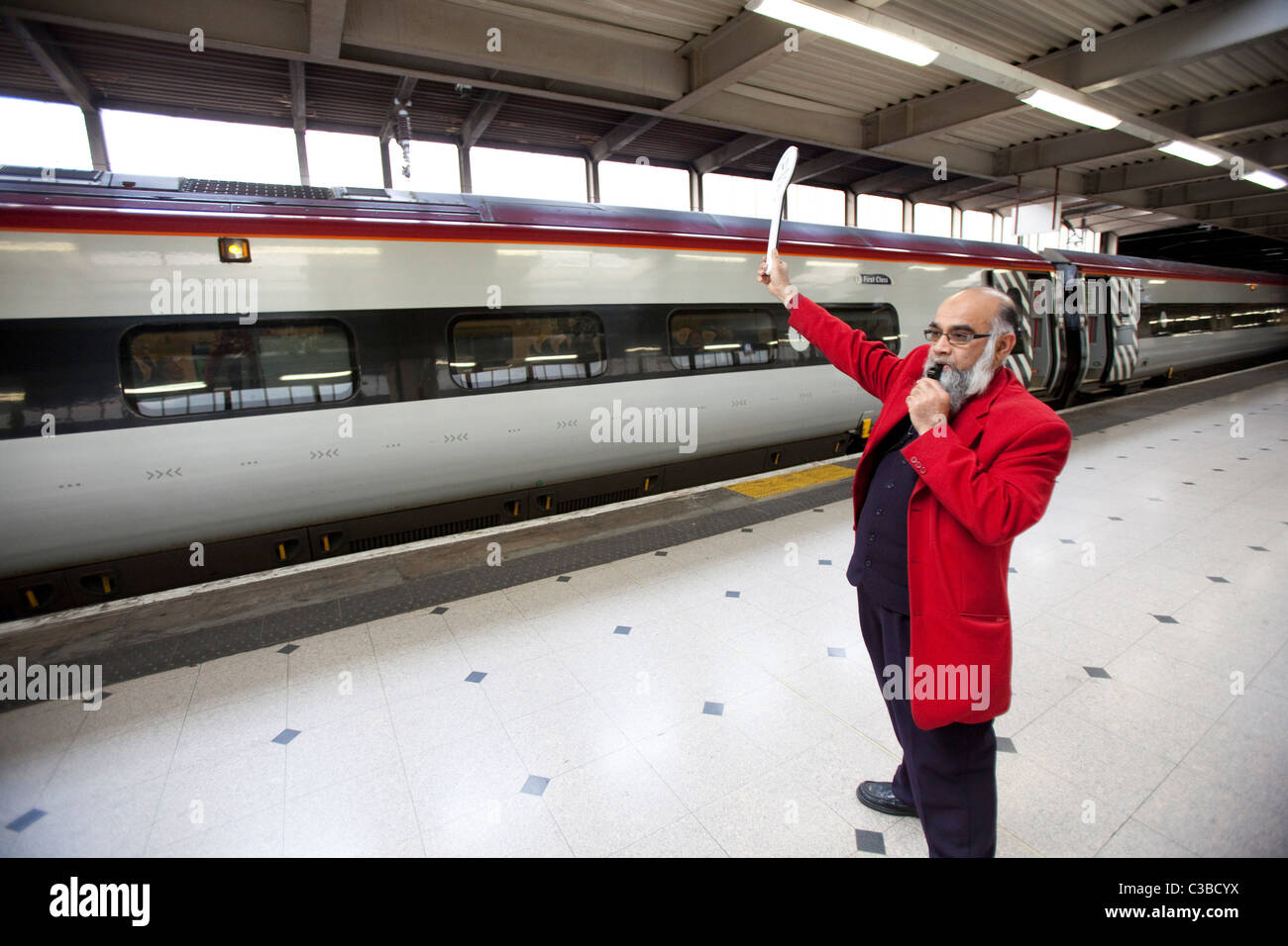 A Virgin Train S Employee At London Euston Station Signals Is Ready For Departure