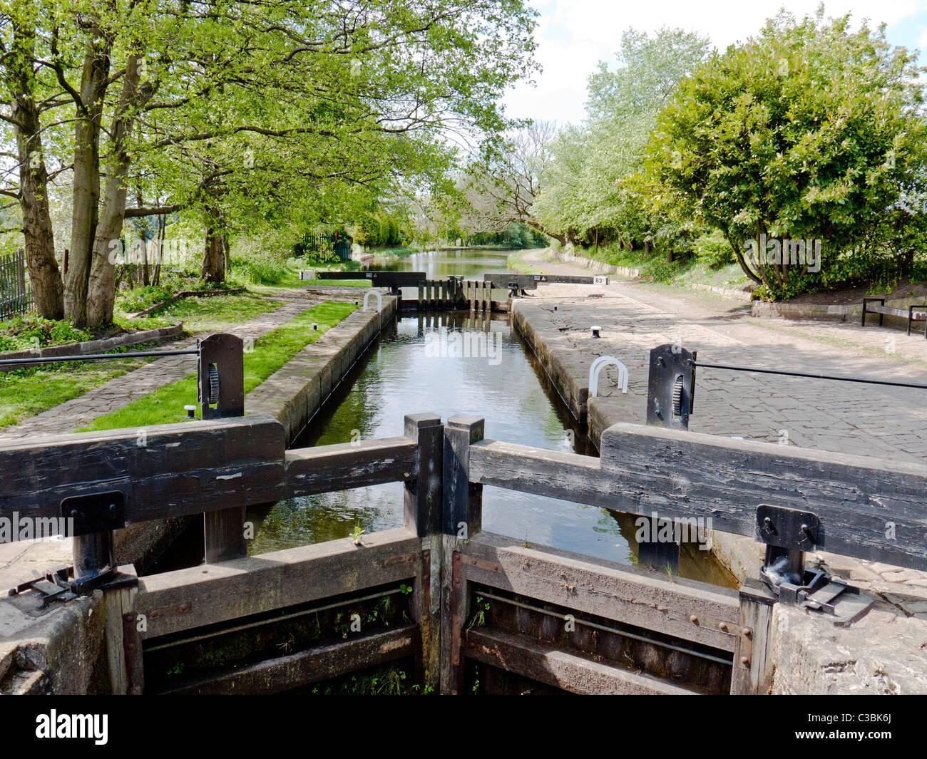 Lock Gates on the Rochdale canal, Chadderton, Oldham, Lancashire, England, UK. - Stock Image