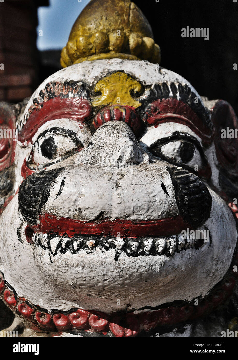 A painted statue on the outskirts of Patan, Nepal - Stock Image