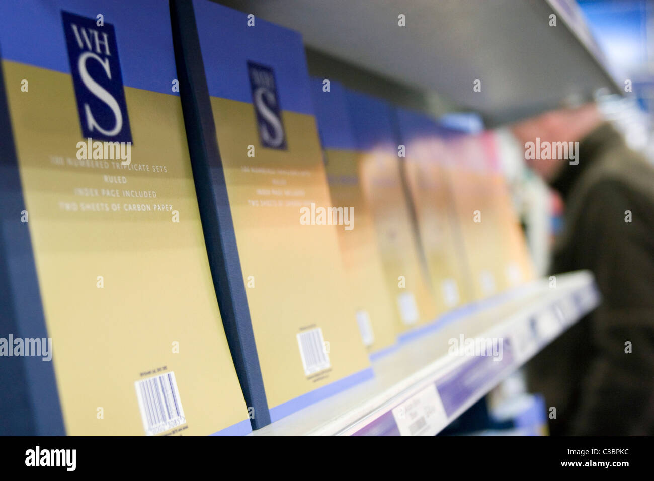 WH smith products displayed on an end of isle shelf. - Stock Image