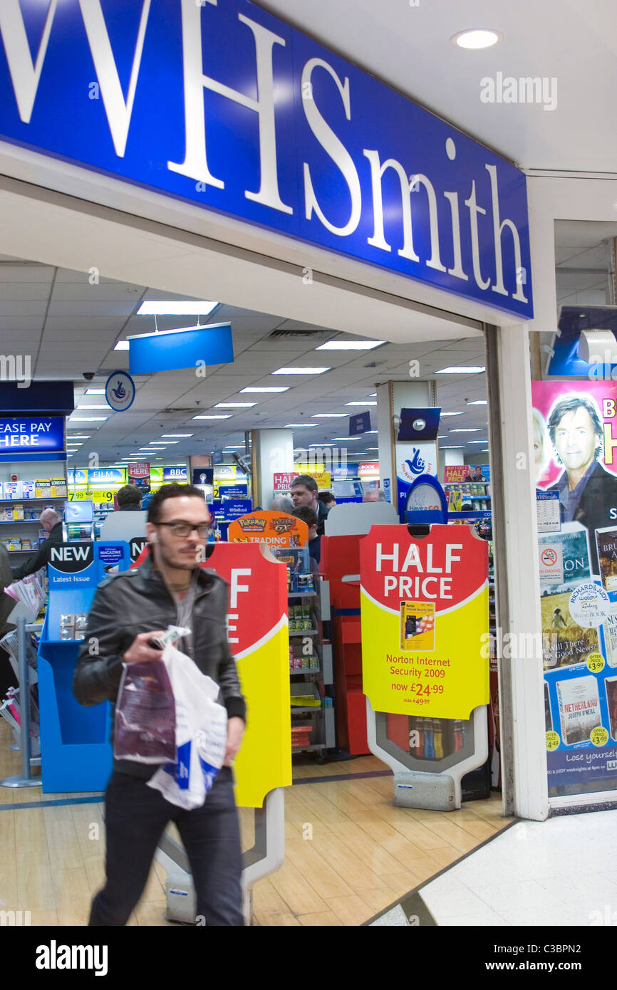 A customer leaving a WH Smith store in Central London. - Stock Image