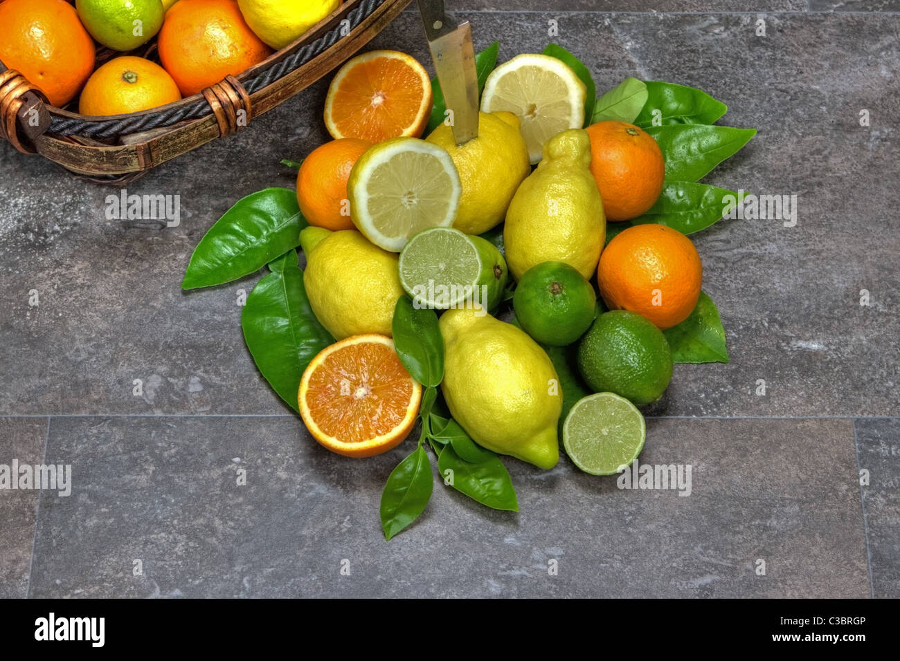 assortment with citrus fruits in a basket - Stock Image