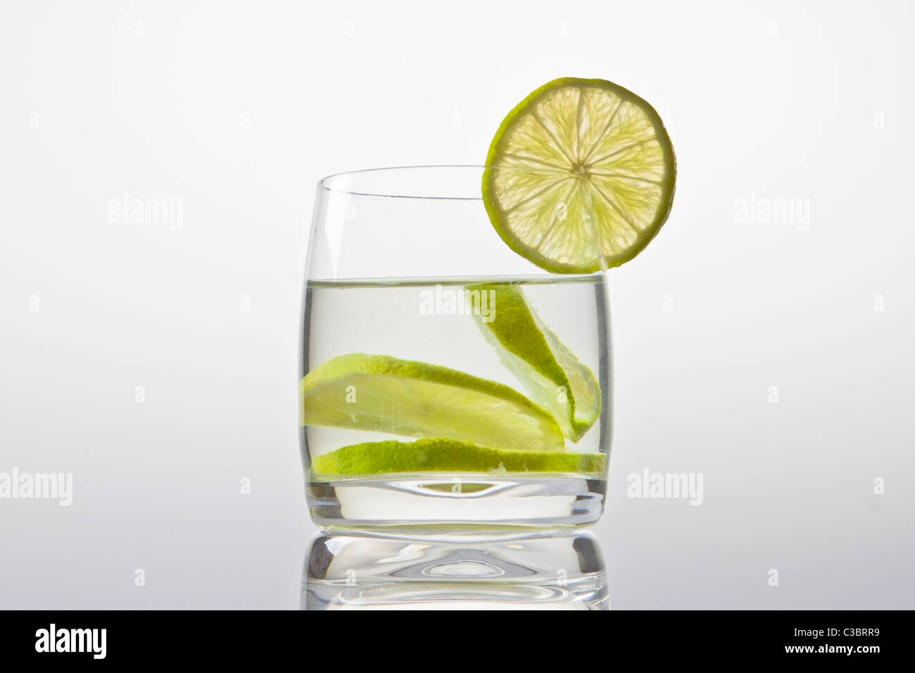 glass with lemonade and lemon slice - Stock Image